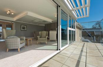 Capstone Care Walshaw Hall – side lounge sunroom